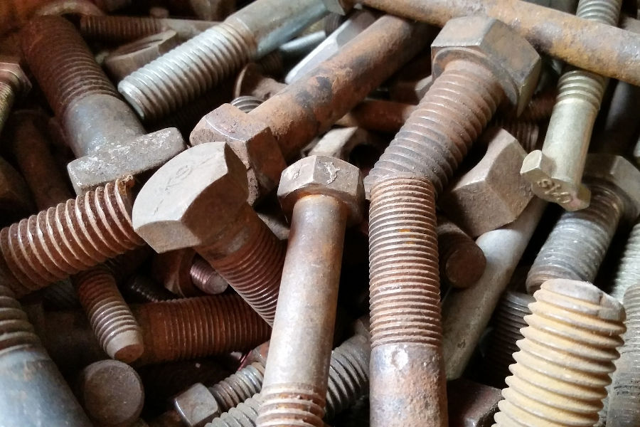 Removing rust from bolts.