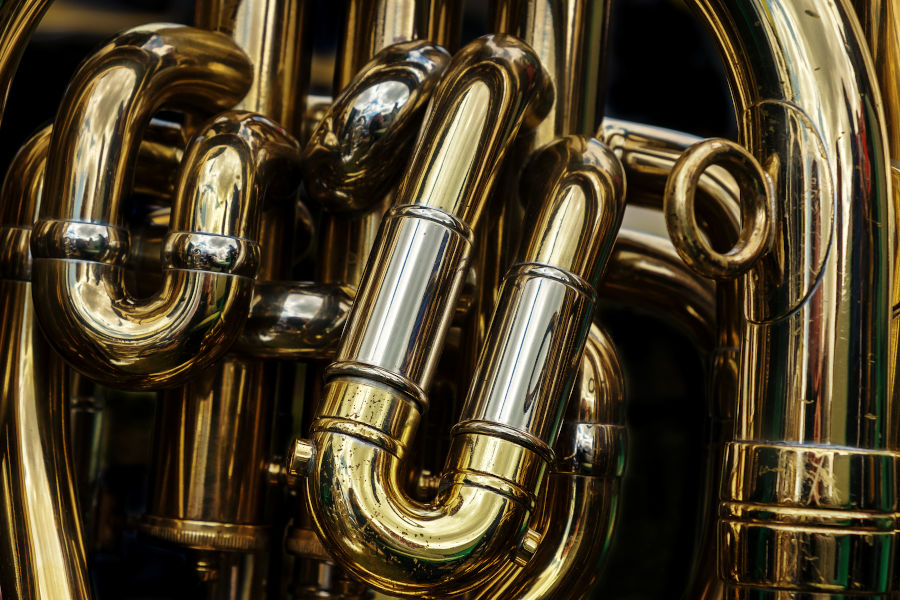 Detail of the brass pipes of a tuba.