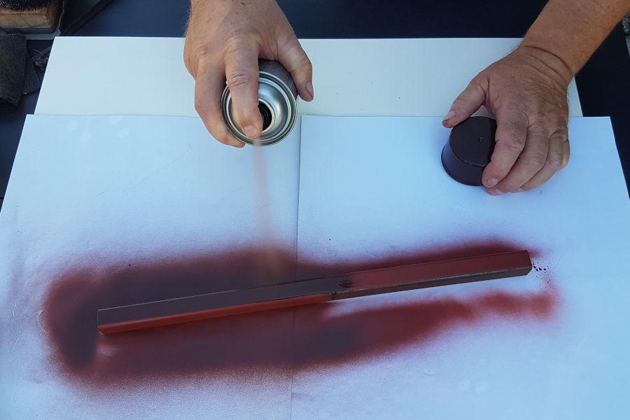 Painting metal bar.