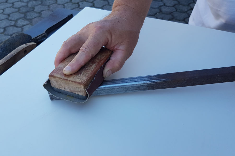 Removing rust with sandpaper.