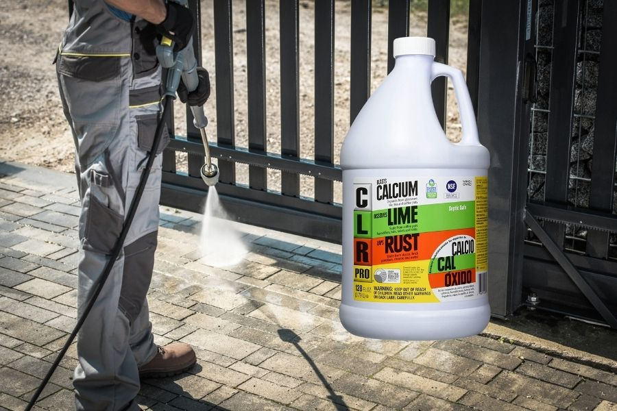 Cleaning rust from concrete with CLR.