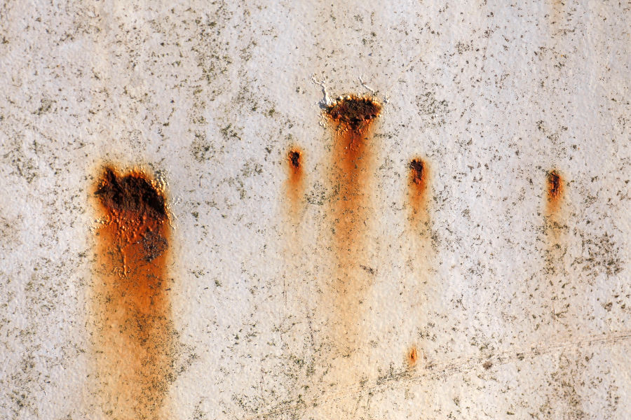 Removing rust stains from concrete surface.